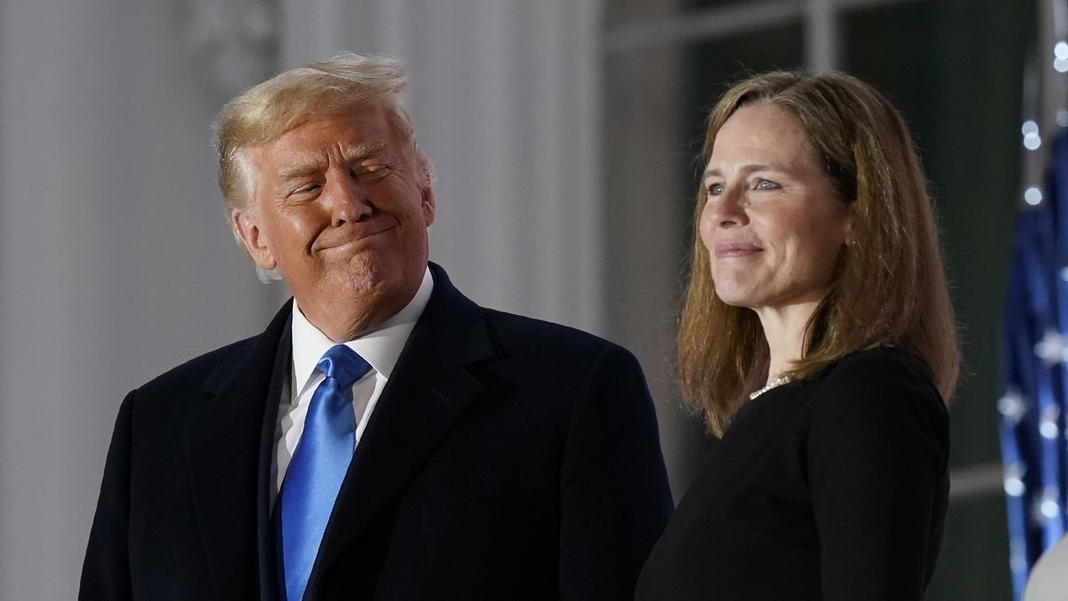 President Donald Trump and Amy Coney Barrett stand on the Blue Room Balcony after Supreme Court...
