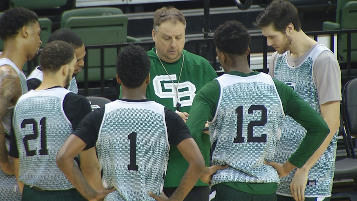 Green Bay mens basketball Head Coach Linc Darner draws up a play during practice on Thursday, Jan. 30 at the Kress Center.