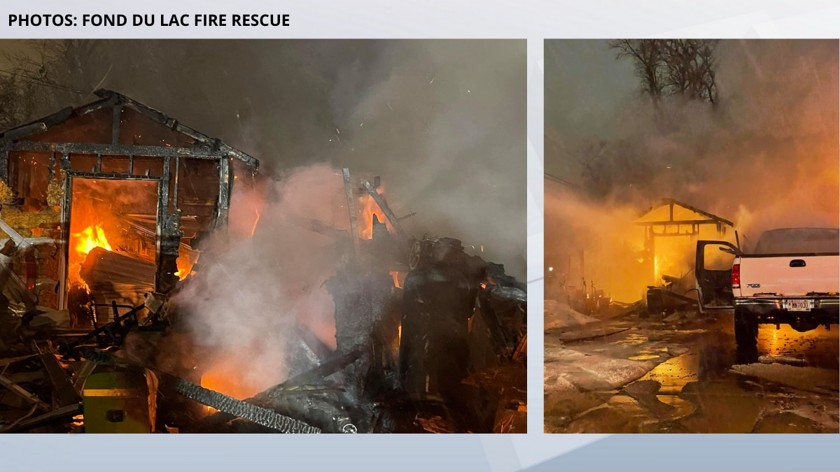 Crews fight a garage fire in Fond du Lac. Feb. 21, 2021.