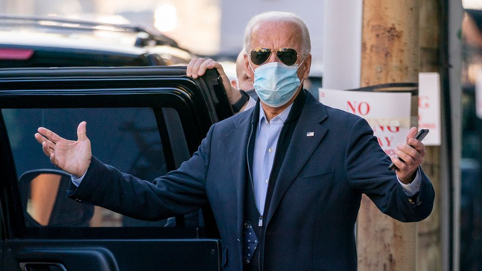 President-elect Joe Biden speaks to reporters as he leaves The Queen theater, Wednesday, Nov....