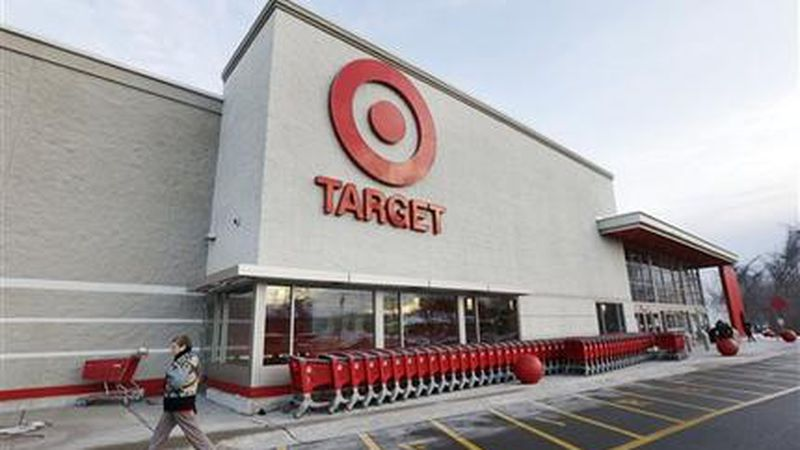 A passer-by walks near an entrance to a Target retail store Thursday, Dec. 19, 2013 in...