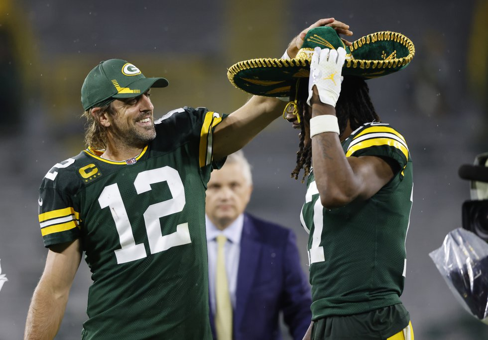 Green Bay Packers quarterback Aaron Rodgers (12) puts on a sombrero on teammate Green Bay...