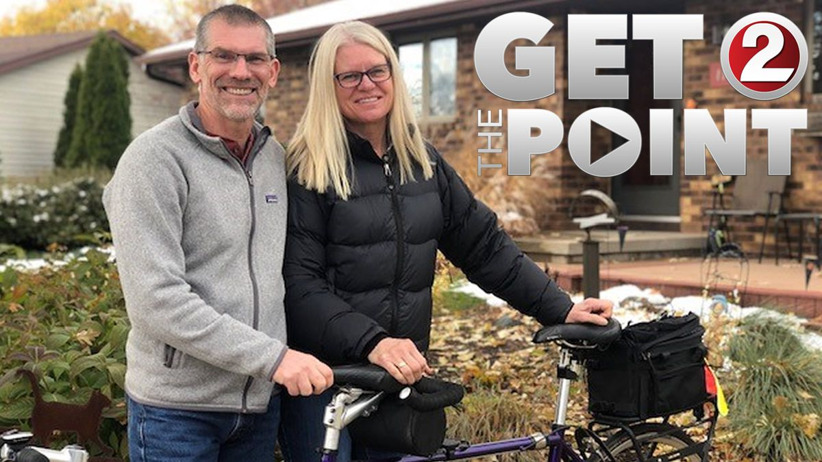 Peter and Tracy Flucke with their tandem bicycle (WBAY photo)