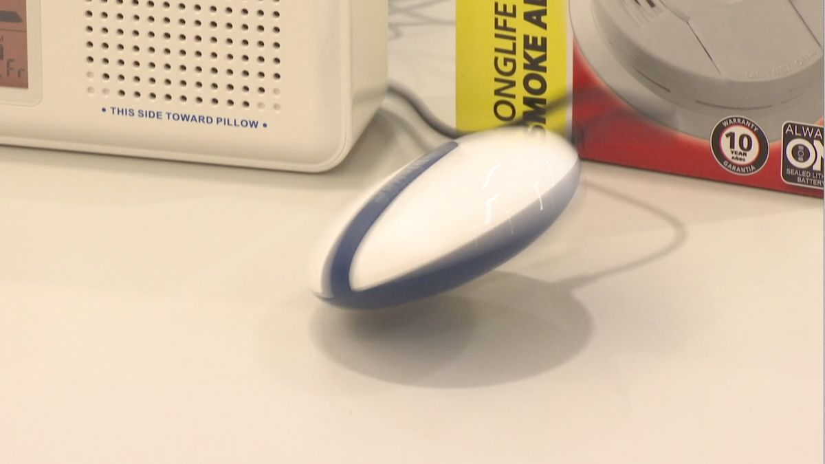 A device that vibrates wildly when triggered by a smoke alarm can be placed under a pillow to alert people who are hard of hearing (WBAY photo)