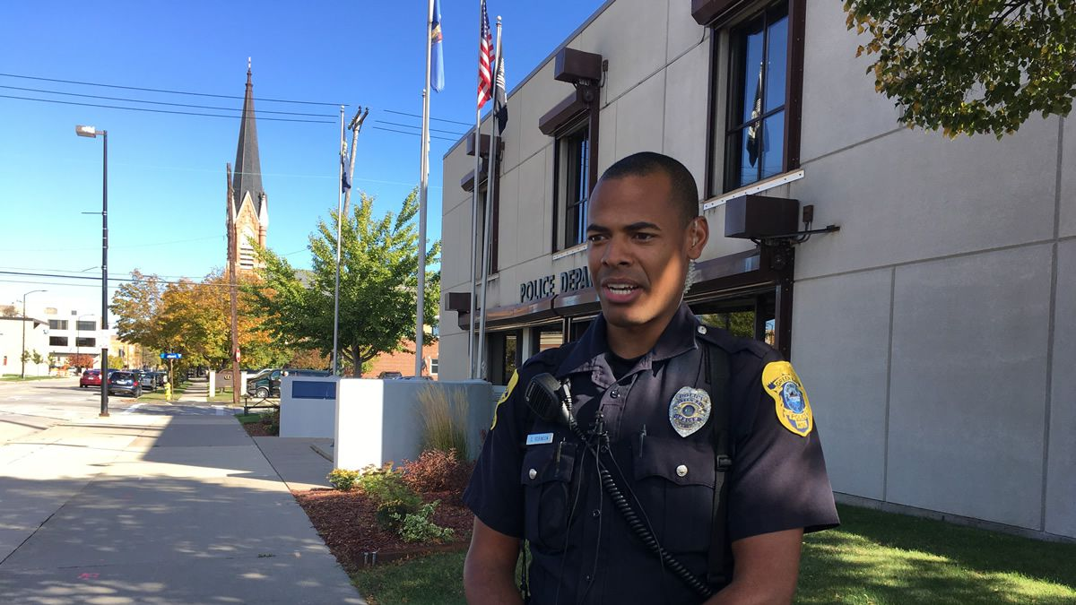 Officer Daryl Robinson in front of the Green Bay Police Department (WBAY photo)