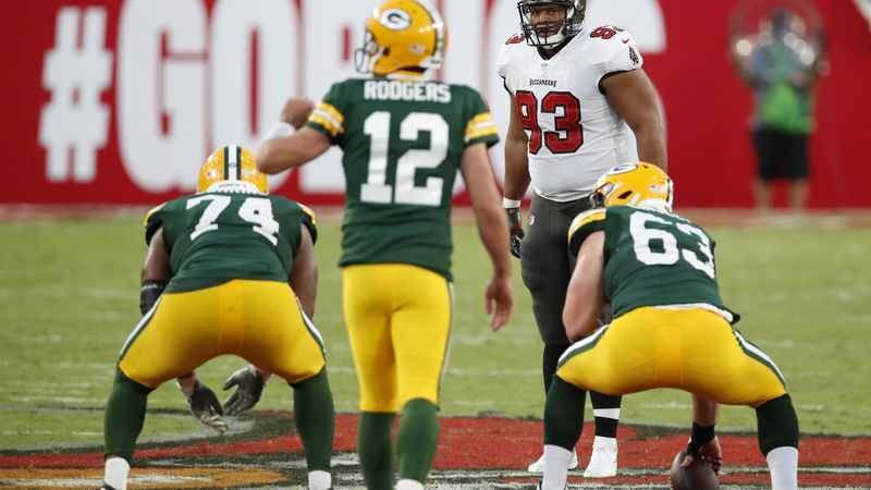 Tampa Bay Buccaneers defensive end Ndamukong Suh (93) lines up against the Green Bay Packers...