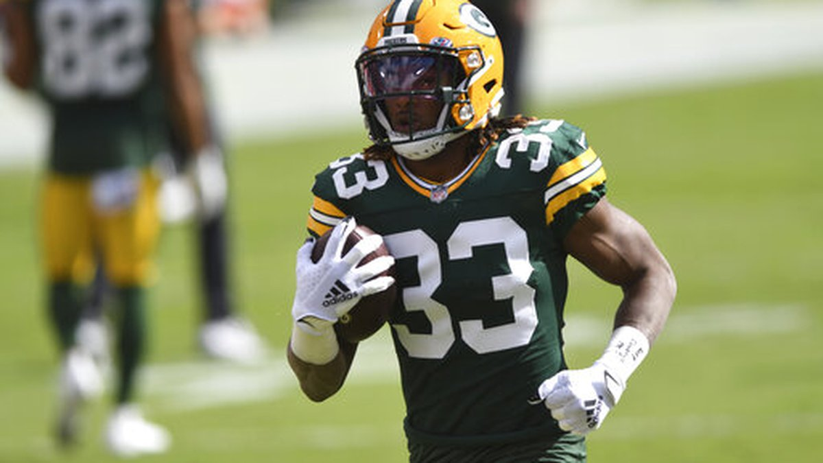 Green Bay Packers running back Aaron Jones (33) before an NFL football game against the Tampa...