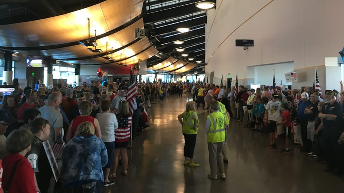 Several thousand people line Appleton Airport to welcome home the 125 veterans on the 40th Old Glory Honor Flight on June 7, 2017. Airport officials say it was by far the largest homecoming crowd the airport has seen. (WBAY photo)