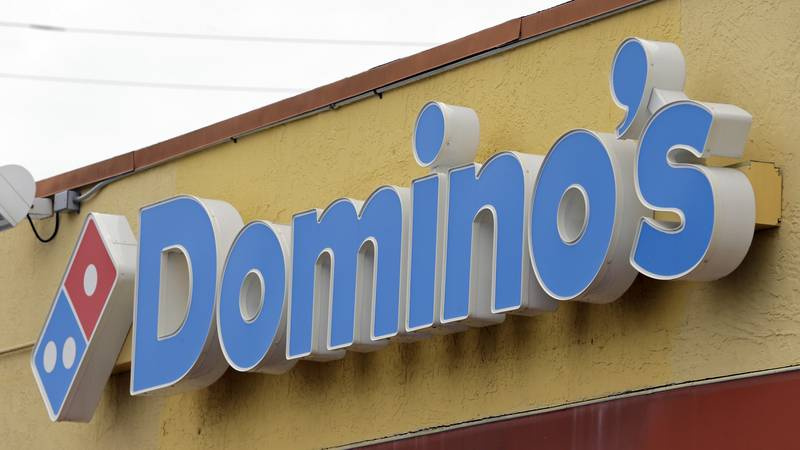 This Thursday, Oct. 27, 2016, photo shows a Domino's Pizza sign at a location in Hialeah, Fla.