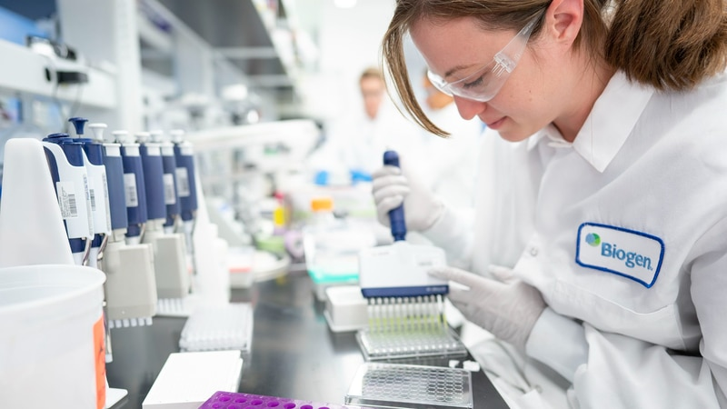 In this Dec. 12, 2019 photo provided by Biogen, a scientist works on Alzheimer's disease...