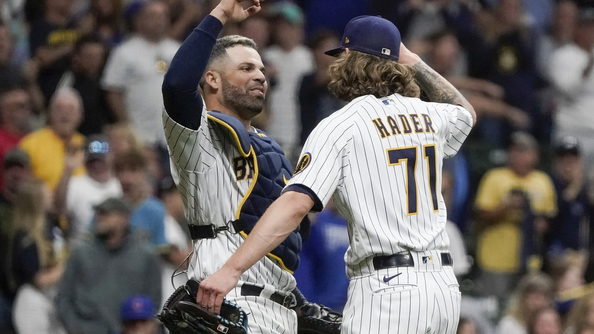 Milwaukee Brewers' Josh Hader and Manny Pina celebrate after a baseball game against the...
