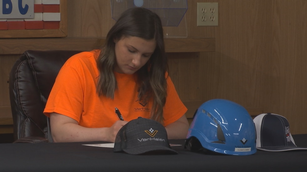 Elizabeth Ciancio, of Gillet High School, signs her intent to enter a career in the trade...